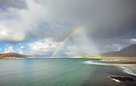 Isle of Lewis and Harris, Scotland: Rainbow and storm clouds over the large sand bay and waters of Luskentyre beach on South Harris Island