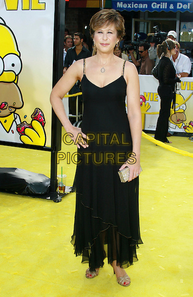 "YEARDLEY SMITH - voice of Lisa Simpson. ""The Simpsons Movie"" World Premiere held at the Mann Village Theater, Westwood, California, USA..July 24th, 2007.full length black dress hand on hip gold clutch purse.CAP/ADM/CH.©Charles Harris/AdMedia/Capital Pictures"