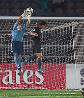 Jack McInerney goes up for the header against Spanish goal keeper Edgar (1). Spain defeated the U.S. Under-17 Men National Team  2-1 at Sani Abacha Stadium in Kano, Nigeria on October 26, 2009.