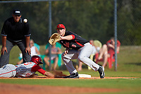 Illinois State Redbirds first baseman Brian Rodemoyer (30) waits for a pickoff attempt throw as Laren Eustace (23) dives back to the bag during a game against the Indiana Hoosiers on March 4, 2016 at North Charlotte Regional Park in Port Charlotte, Florida.  Indiana defeated Illinois State 14-1.  (Mike Janes/Four Seam Images)