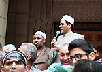 "Egyptian Sheik Mazhar Shahin, is surrounded by his supporters as he take part in a protest in the Kasr el Dobara Evangelical Church in Cairo, Egypt, Friday, April 12, 2013. A Muslim cleric, who became known as ""the preacher of the revolution"" for his sermons in Tahrir Square during the uprising against ousted President Hosni Mubarak and subsequent anti-government protests, said he was suspended Tuesday by a ministerial decree following a citizen's complaint about his criticism of the current Islamist president. Photo by Tarek al-Gabas"