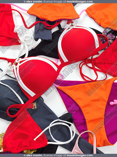 Different colorful bikini swimsuits abstract background