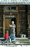 SWEDEN, Swedish Lapland, Children and Woman with a Crepe on a Doorway