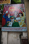 A Communist propaganda poster adorns the wall outside a local People's Committee office in Ho Chi Minh City, Vietnam. July 3, 2011.
