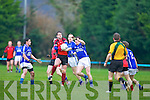 Raymond O'Connor Glenbeigh/Glencar sweeps up the loose ball ahead of Maurice Foley Laune Rangers during the Mid Kerry Championship final in Beaufort on Saturday