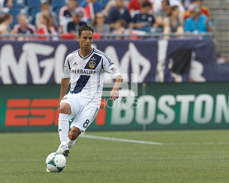 LA Galaxy midfielder Marcelo Sarvas (8) dribbles. In a Major League Soccer (MLS) match, the New England Revolution (blue) defeated LA Galaxy (white), 5-0, at Gillette Stadium on June 2, 2013.