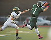 Jeremy Ruckert #1 of Lindenhurst, right, reels in a pass for a first down as Andrew McKenna #22 of Ward Melville closes in on him during the first quarter of a Suffolk County Division I varsity football game at Lindenhurst Middle School on Friday, Oct. 7, 2016. Lindenhurst went to halftime leading 16-7.