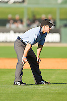 Umpire Ramon Hernandez handles the calls on the bases during the South Atlantic League game between the Hickory Crawdads and the Kannapolis Intimidators at Fieldcrest Cannon Stadium on April 17, 2011 in Kannapolis, North Carolina.   Photo by Brian Westerholt / Four Seam Images
