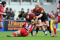 Nick Auterac is tackled in possession. Aviva Premiership match, between Saracens and London Welsh on March 3, 2013 at Allianz Park in London, England. Photo by: Patrick Khachfe / Onside Images