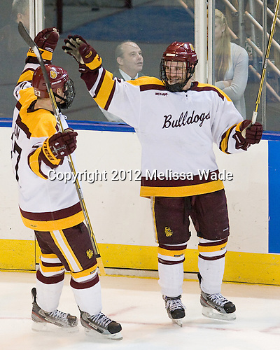 David Grun (Duluth - 27), Jake Hendrickson (Duluth - 15) - The University of Minnesota Duluth Bulldogs defeated the University of Maine Black Bears 5-2 in their NCAA Northeast semifinal on Saturday, March 24, 2012, at the DCU Center in Worcester, Massachusetts.