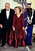 First lady Hillary Rodham Clinton, center, and Chancellor Helmut Kohl of Germany, left, stand at the Grand Staircase of the White House in Washington, DC as she and United States President Bill Clinton welcome the Chancellor for an Official Dinner on Thursday, February 9, 1995.<br /> Credit: John Harrington / Pool via CNP