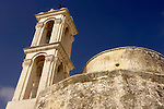Travel stock photo of an Ancient orthodox church Timios Stavros bell tower over blue sky Parekklisia village near Limassol in Cyprus Horizontal