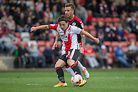 Jack Munns of Cheltenham scores his side's second goal during the Sky Bet League 2 match between Cheltenham Town and Crawley Town at the LCI Rail Stadium, Cheltenham, England on 15 October 2016. Photo by Mark  Hawkins.