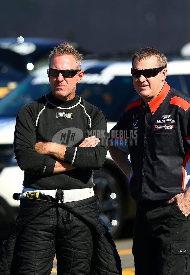 Jul. 26, 2013; Sonoma, CA, USA: NHRA top fuel dragster driver Tommy Johnson Jr (left) with crew member during qualifying for the Sonoma Nationals at Sonoma Raceway. Mandatory Credit: Mark J. Rebilas-