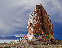 Two very large rocks jut from the rocky beach at Namtso Lake in central Tibet.  These rocks have an interesting myth behind it.  According to our guide, A giant was killing nomads and their yaks so a Lama was sent from Lhasa who battled the giant for several years.  When you finally defeated the giant he was encasing him in stone.  The giant was repentant and begging for mercy so the Lama left his hands exposed and told the giant that he would be freed when enough time had passed.