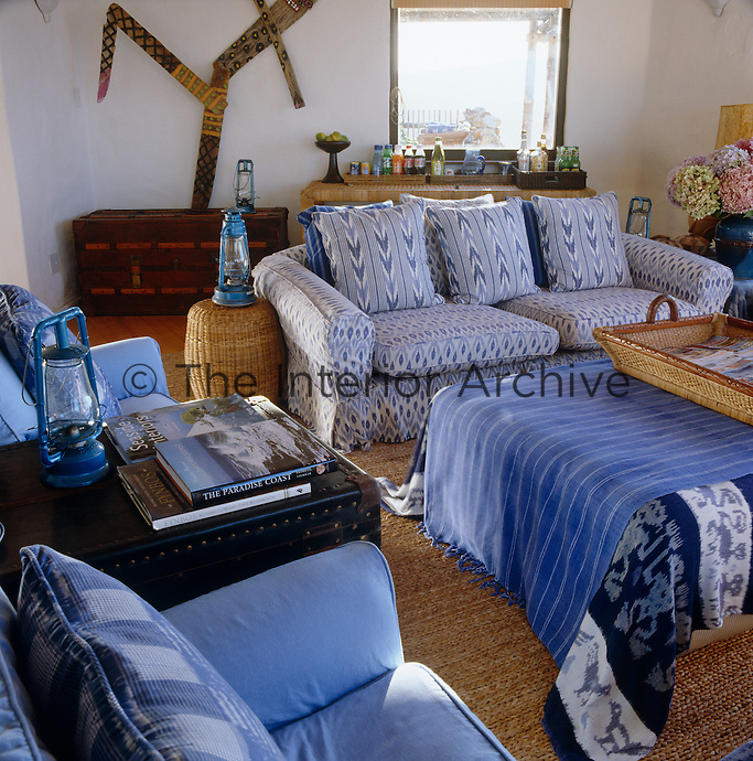 The blue and white fabrics used in the living room were sourced from India and Malabar