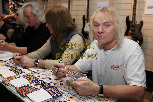 Uriah Heep.Concert in Moscow.February 13th, 2010.half length table sitting signing autographs white t-shirt .CAP/PER/SB.© SB/Persona/CapitalPictures