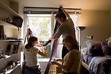 Stanford freshman orientation. Bria Long and her parents, Ron Long and Leah Brammer hang a curtain trim in her Rinconada dorm room.