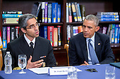 Vivek Murthy, United States surgeon general, left, speaks while participating in a roundtable discussion on the impacts of climate change on public health at Howard University with U.S. President Barack Obama in Washington, D.C., U.S., on Tuesday, April 7, 2015. The President is warning that climate change will start affecting Americans' health in the near future and he is recruiting top technology companies to help prepare the nation's health systems.<br /> Credit: Andrew Harrer / Pool via CNP