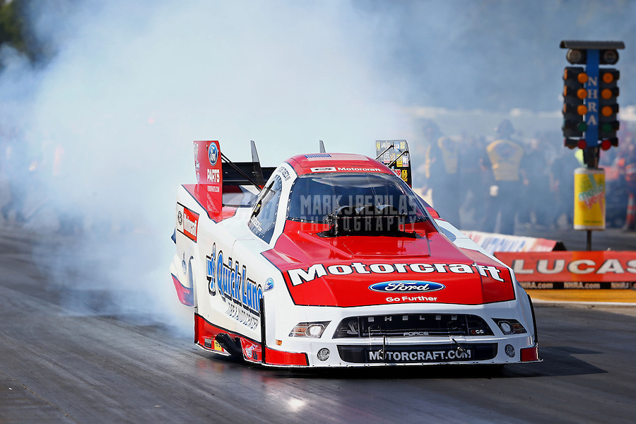 Aug. 16, 2013; Brainerd, MN, USA: NHRA funny car driver Bob Tasca III during qualifying for the Lucas Oil Nationals at Brainerd International Raceway. Mandatory Credit: Mark J. Rebilas-