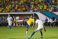 Miami, FL - Saturday, Nov 16, 2013: Brazil vs Honduras during an international friendly at Miami's Sun Life Stadium. Brazilian Robinho controls the ball while defender Juan Pablo watches it.