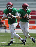 NWA Democrat-Gazette/ANDY SHUPE<br /> Arkansas quarterbacks Austin Allen (left) and Ty Storey drop back to pass Saturday, Aug. 5, 2017, prior to the start of a scrimmage in Razorback Stadium in Fayetteville. Visit nwadg.com/photos to see more photographs from the practice.