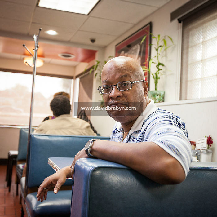 HSUL 20140819 United States, St Louis, MO. Reverend Earl E. Nance Jr poses for the photographer at the Goody Good Diner in St Louis, MO, on August 19, 2014. Photographer: David Brabyn