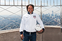 Former men's national team player Cobi Jones poses for a photo on the observation deck of the Empire State Building during the centennial celebration of U. S. Soccer in New York, NY, on April 05, 2013.