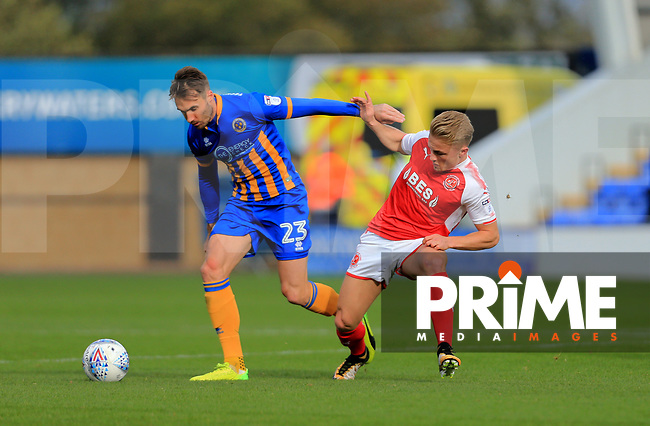 Kyle Dempsey of Fleetwood Town battles Alex Rodman of Shrewsbury Town during the Sky Bet League 1 match between Shrewsbury Town and Fleetwood Town at Greenhous Meadow, Shrewsbury, England on 21 October 2017. Photo by Leila Coker / PRiME Media Images.