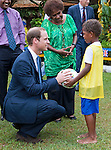"""PRINCE WILLIAM.presents a football  to a child_17/09/2012.Mandatory credit photo: ©Jones-DIASIMAGES/NEWSPIX INTERNATIONAL..""""NO UK USE FOR 28 DAYS"""" ..(Failure to credit will incur a surcharge of 100% of reproduction fees)..                **ALL FEES PAYABLE TO: """"NEWSPIX INTERNATIONAL""""**..IMMEDIATE CONFIRMATION OF USAGE REQUIRED:.DiasImages, 31a Chinnery Hill, Bishop's Stortford, ENGLAND CM23 3PS.Tel:+441279 324672  ; Fax: +441279656877.Mobile:  07775681153.e-mail: info@newspixinternational.co.uk"""