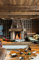 Sunken seating built around the fireplace in the living area has created a cosy place to relax and enjoy a roaring fire
