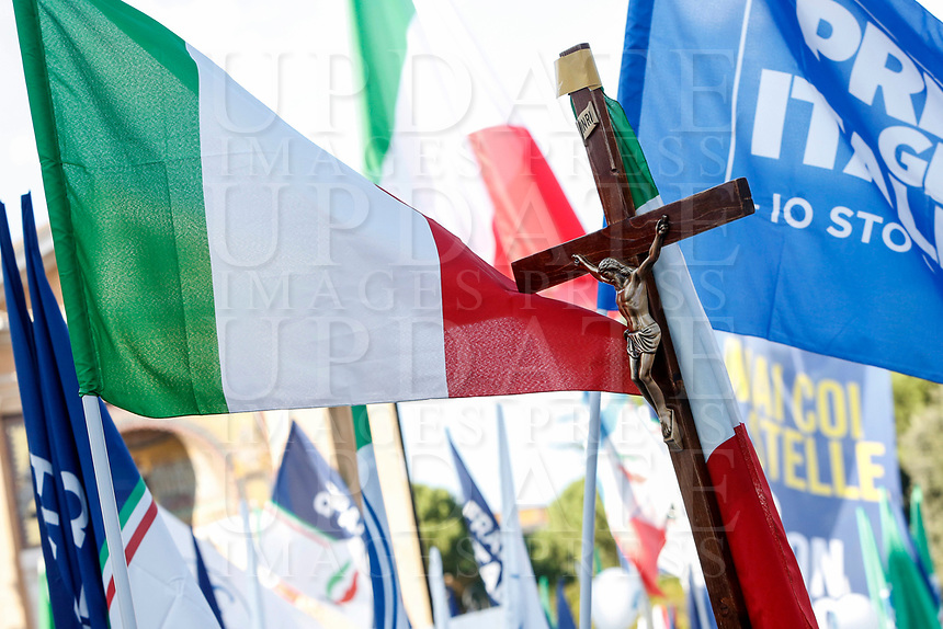 "A crucifix is seen among Italian tricolor flags during the so-called ""Italian Pride!"" political rally attended by right parties' leaders against government's economic policies in St. John Lateran Square, Rome, Italy, October 19, 2019.<br /> Update Images Press/Riccardo De Luca"