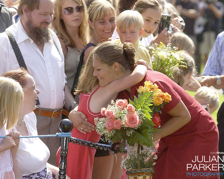 CROWN PRINCESS VICTORIA OF SWEDEN CELEBRATES HER 25TH BIRTHDAY, .WITH HER PARENTS, AT SOLLIDEN, NEAR BERGHOLM, SWEDEN..14/7/02.  PICTURE: UK PRESS   (ref 5105-6)