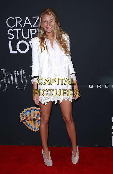 BLAKE LIVELY.Warner Brothers Pictures presents The Big Picture 2011 at Cinemacon at Caesars Palace Las Vegas, Las Vegas, Nevada, USA..March 31st, 2011.full length white jacket dress lace beige shooboots shoe boots booties blazer .CAP/ADM/MJT.© MJT/AdMedia/Capital Pictures.