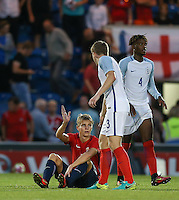 Matt Targett (Southampton) of England consoles Martin Odegaard (Real Madrid) of Norway during the International EURO U21 QUALIFYING - GROUP 9 match between England U21 and Norway U21 at the Weston Homes Community Stadium, Colchester, England on 6 September 2016. Photo by Andy Rowland / PRiME Media Images.