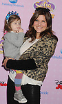 """BURBANK, CA - NOVEMBER 10: Tiffani Thiessen and daughter arrive at the Disney Channel's Premiere Party For """"Sofia The First: Once Upon A Princess"""" at the Walt Disney Studios on November 10, 2012 in Burbank, California."""