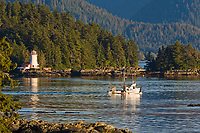 "Commercial trolling vessel ""Moonlight"" passes through Sitka Sound, southeast, Alaska."