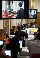Quebec City, March 13, 2007 - Journalists watch the debate between Jean Charest, Mario Dumont and André Boisclair at the National Assembly Tuesday, March 13, 2007. Quebecers will cast their vote on March 26.
