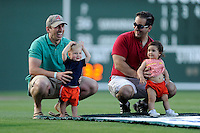 Dads and their toddlers participate in an in-game toddler race contest during a game between the Savannah Sand Gnats and Greenville Drive on Wednesday, May 29, 2013, at Fluor Field at the West End in Greenville, South Carolina. (Tom Priddy/Four Seam Images)
