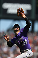 SAN FRANCISCO, CA - JUNE 28:  Nolan Arenado #28 of the Colorado Rockies catches a pop up at third base against the San Francisco Giants during the game at AT&T Park on Wednesday, June 28, 2017 in San Francisco, California. (Photo by Brad Mangin)