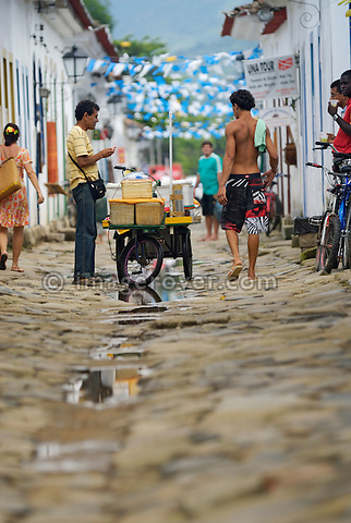 Brazil, Paraty: Local brazilian man selling goods of his mobile shop in the historic center. The beautiful colonial town of Paraty has been a UNESCO World Heritage Site since 1958. --- No signed releases available.