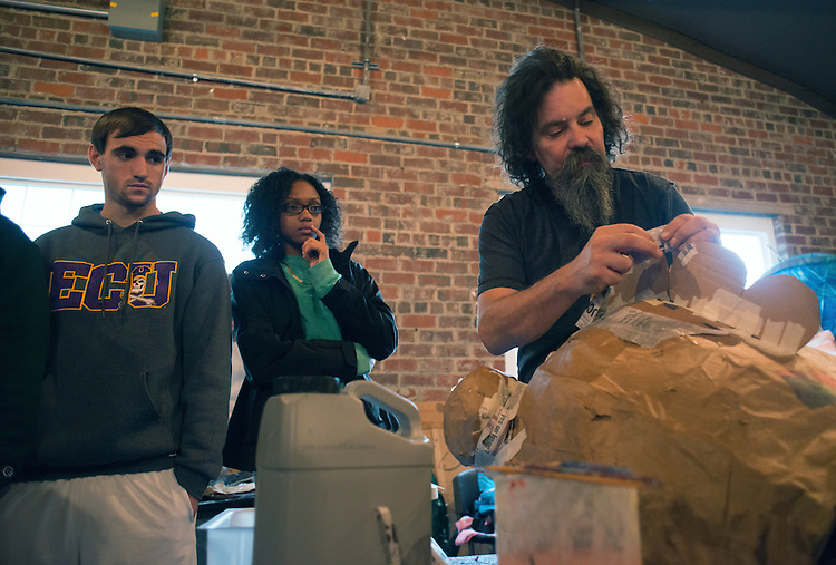 Artist in Residence Daniel Polnau demonstrates to Ohio University students how to paper mache at Honey for the Heart located at 29 E. Carpenter St. in Athens, Ohio.
