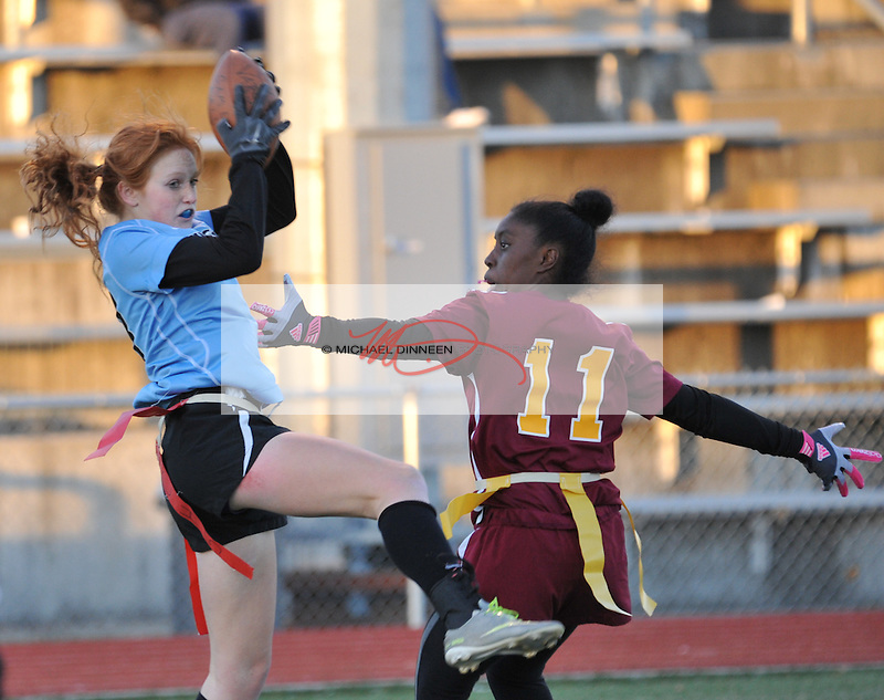 Carson Head pulls down a pass in their CIC Flag Football playoff game Thursday, Oct 13, 2016.  Photo for the Star by Michael Dinneen