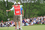 Graeme McDowell celebrates after winning with caddy Ken Comboy on the 18th on the final day of the Celtic Manor Wales Open 2010.Picture Fran Caffrey/Newsfile.ie