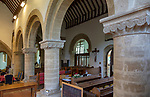 Norman arches inside village parish church of the Holy Cross, Sherston, Wiltshire, England, UK