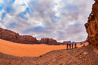 Travelers enjoy a panoramic view of the Arabian Desert at Wadi Rum, Jordan.