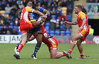 Warrington Wolves' Ben Murdoch-Masila is tackled by Catalans Dragons' Benjamin Jullien (right) and Sam Tomkins <br /> <br /> Photographer Stephen White/CameraSport<br /> <br /> Betfred Super League Round 17 - Warrington Wolves v Catalans Dragons - Saturday 8th June 2019 - Halliwell Jones Stadium - Warrington<br /> <br /> World Copyright © 2019 CameraSport. All rights reserved. 43 Linden Ave. Countesthorpe. Leicester. England. LE8 5PG - Tel: +44 (0) 116 277 4147 - admin@camerasport.com - www.camerasport.com
