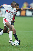 Damani Ralph of the Fire and Ricardo Clark of the MetroStars go stride for stride. The Chicago Fire defeated the NY/NJ MetroStars 3-2 on 6/14/03 at Giant's Stadium, NJ..