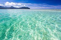 The ocean gently ripples above the Kane'ohe Sandbar, with the Ko'olau Range in the distance, O'ahu.