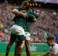 South Africa's Sibusiso Nkosi celebrates scoring his sides first try with South Africa's Aphiwe Dyantyi and South Africa's Eben Etzebeth<br /> <br /> Photographer Bob Bradford/CameraSport<br /> <br /> Quilter Internationals - England v South Africa - Saturday 3rd November 2018 - Twickenham Stadium - London<br /> <br /> World Copyright © 2018 CameraSport. All rights reserved. 43 Linden Ave. Countesthorpe. Leicester. England. LE8 5PG - Tel: +44 (0) 116 277 4147 - admin@camerasport.com - www.camerasport.com